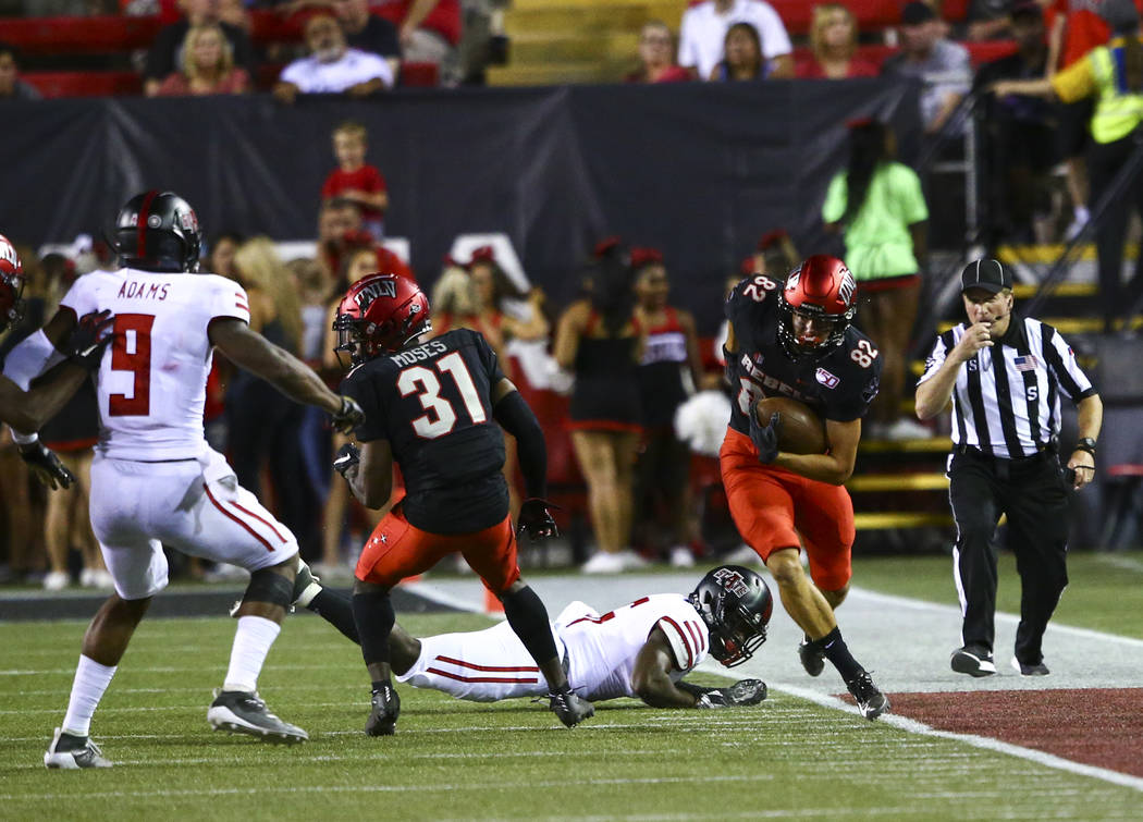 UNLV Rebels quarterback Armani Rogers (1) throws a pass during the first half of an NCAA footba ...