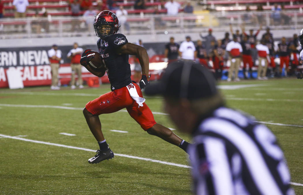 UNLV Rebels wide receiver Randal Grimes runs the ball to score a touchdown against the Arkansas ...