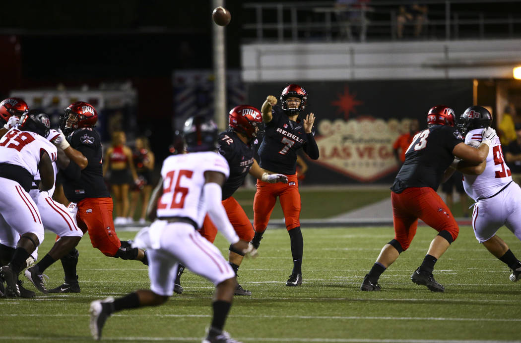 UNLV Rebels quarterback Kenyon Oblad (7) throws a pass during the second half of an NCAA footba ...