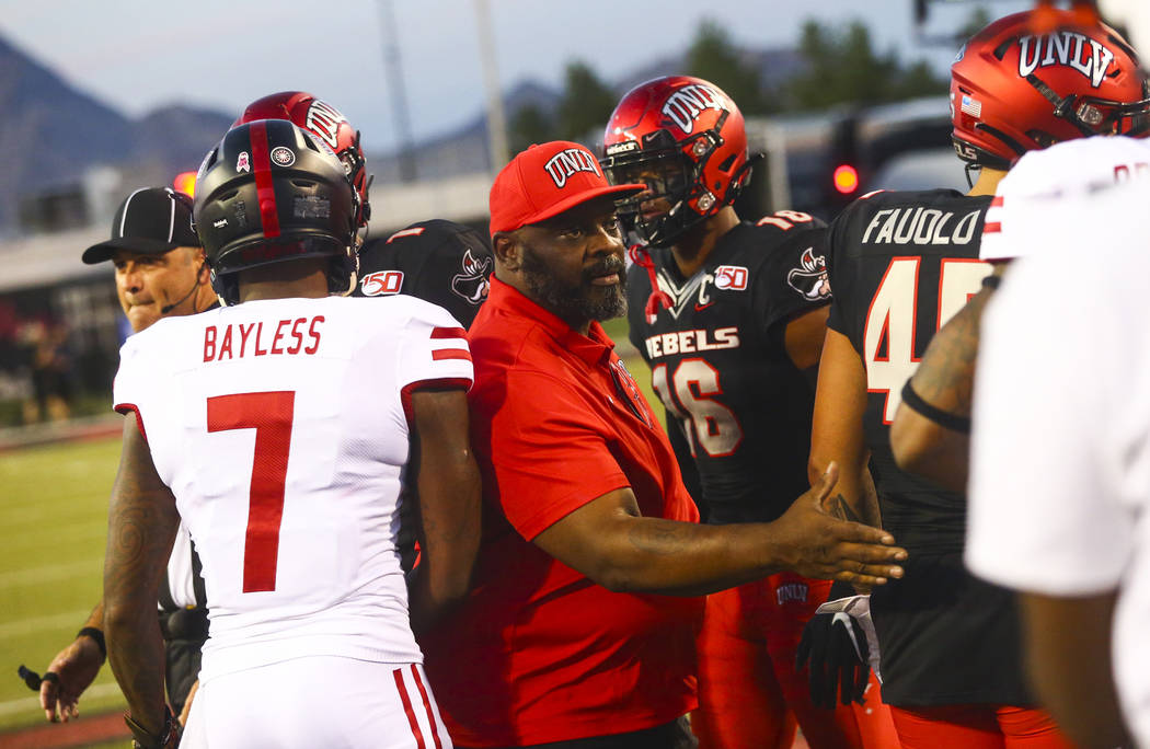 Former UNLV football player Ickey Woods greets players after participating in the coin toss bef ...