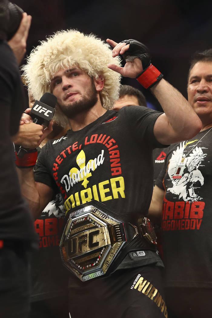 Russian UFC fighter Khabib Nurmagomedov speaks after wining against UFC fighter Dustin Poirier, ...