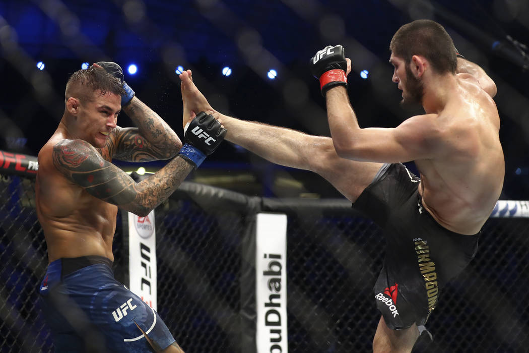 Russian UFC fighter Khabib Nurmagomedov, right, kicks UFC fighter Dustin Poirier, of Lafayette, ...