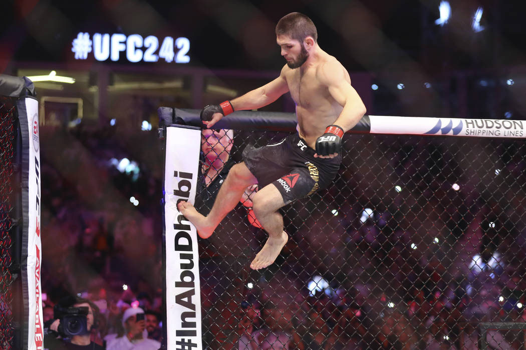 Russian UFC fighter Khabib Nurmagomedov, jumps during Lightweight title mixed martial arts bout ...