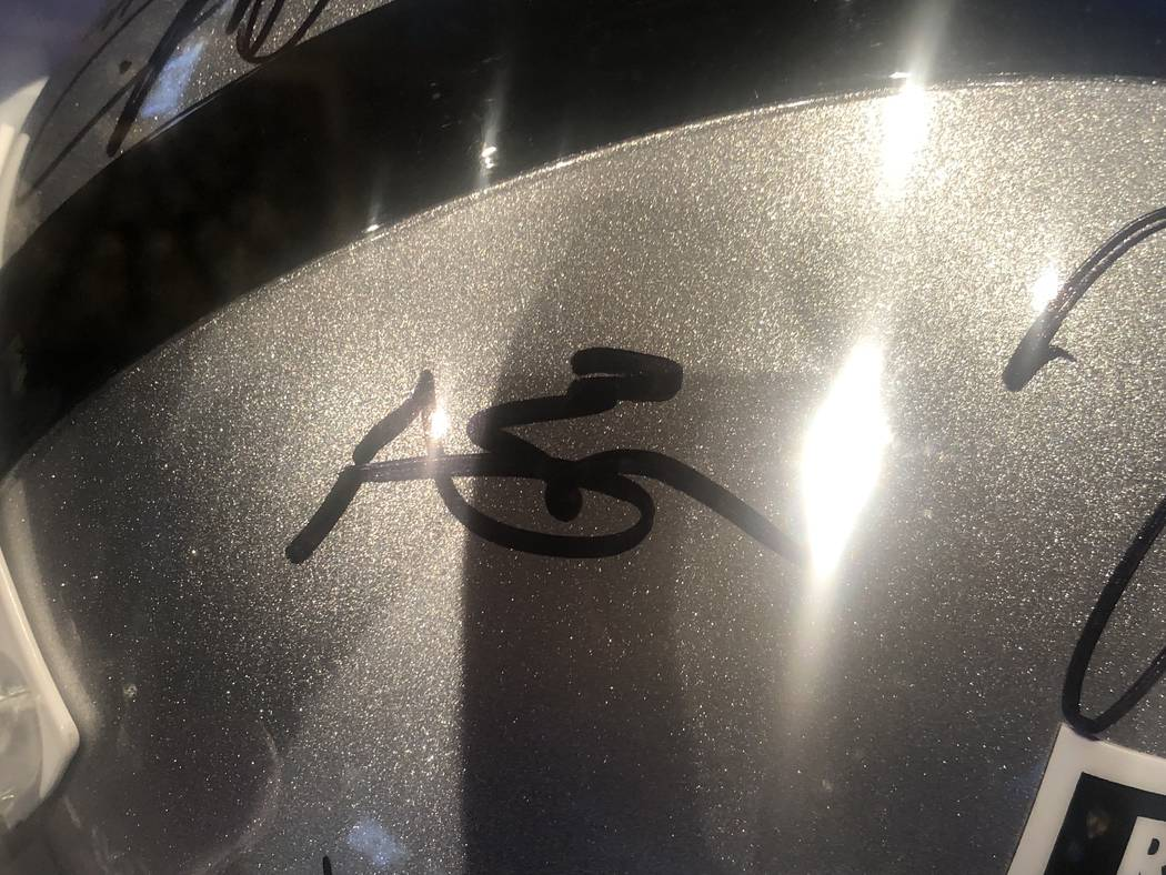 Antonio Brown's signature is shown on a Raiders' helmet at the sixth annual TRF Gala on Friday, ...