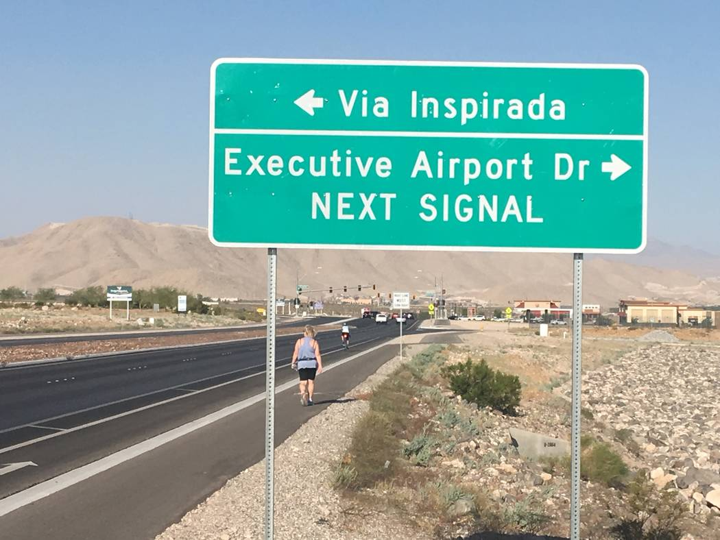 Investigators on scene after a small propeller plane crashed near Henderson Executive Airport o ...