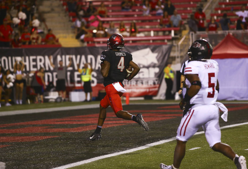 UNLV Rebels wide receiver Randal Grimes scores a touchdown against the Arkansas State Red Wolve ...