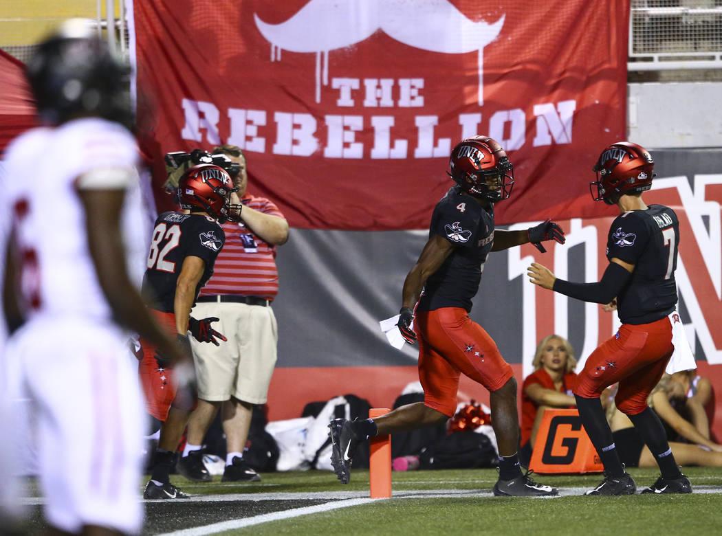 UNLV Rebels wide receiver Randal Grimes (4) celebrates his touchdown with quarterback Kenyon Ob ...