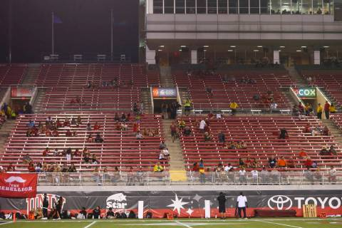 UNLV Rebels fans leave the game during the second half of an NCAA football game against the Ark ...