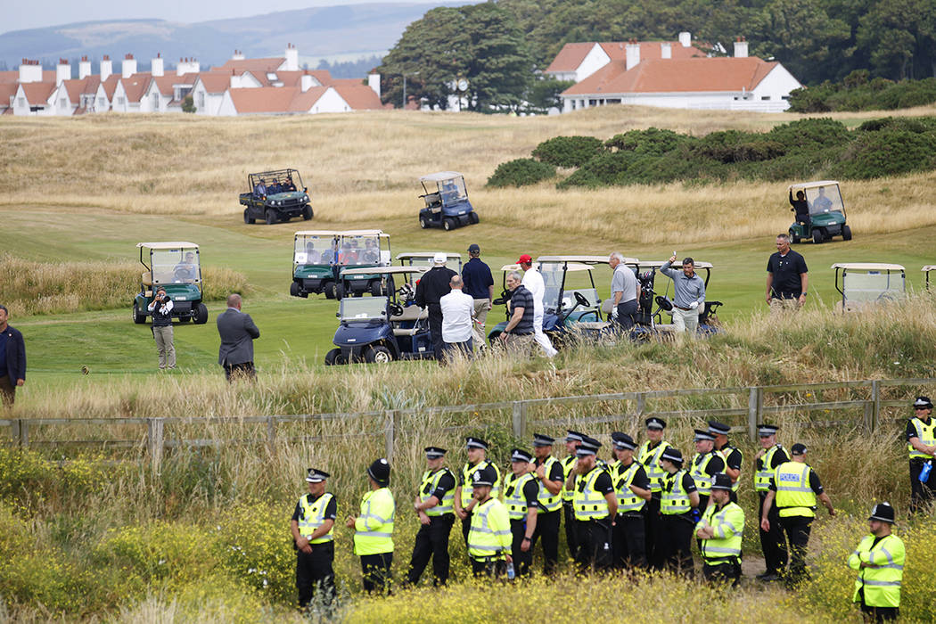FILE--President Donald Trump plays golf under tight security at Turnberry golf club, in Turnber ...