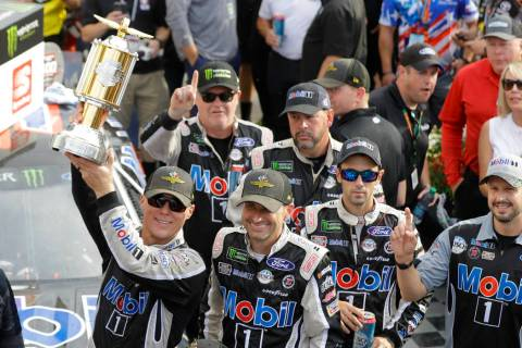Kevin Harvick, left, celebrates after winning the NASCAR Brickyard 400 auto race at Indianapoli ...
