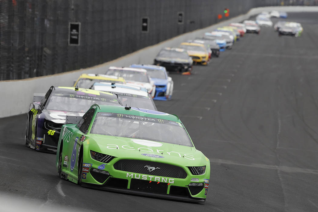 Ryan Newman leads driver Jimmie Johnson into Turn 1 during the NASCAR Brickyard 400 auto race a ...