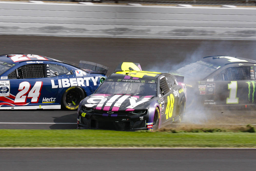 NASCAR driver Jimmie Johnson (48) makes contact with Kurt Busch (1) in the second turn during t ...