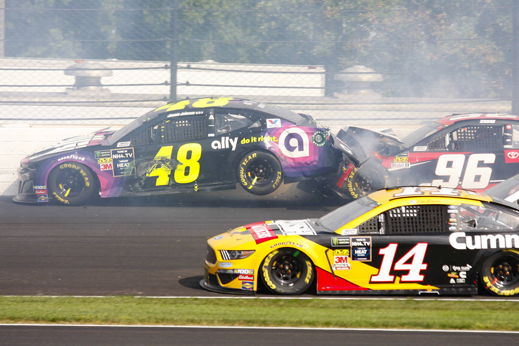 NASCAR driver Jimmie Johnson (48) is hit by Parker Kligerman (96) in the second turn during the ...