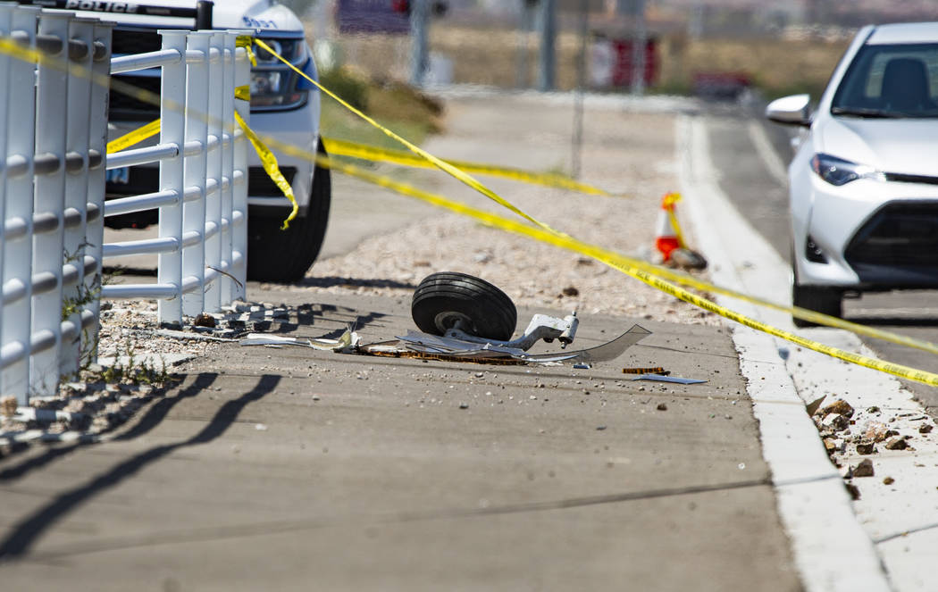 A piece of the plane that crashed Saturday night south of the Henderson Executive Airport in He ...