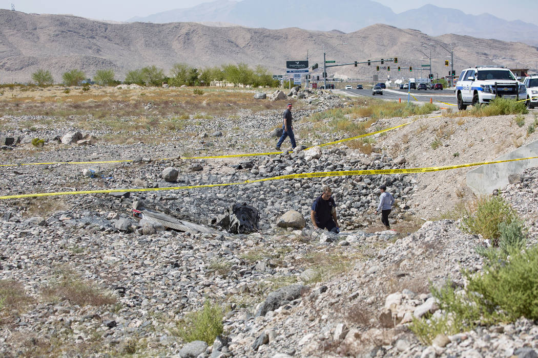 Federal Aviation Administration employees investigate the scene of an airplane crash from Satur ...