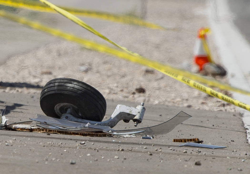 A wheel at the scene of an airplane crash from Saturday night south of the Henderson Executive ...