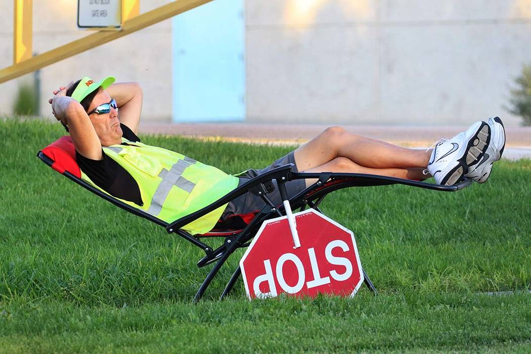 Dennis Noel of Las Vegas, a crossing guard, relaxes as he waits to assist Elise Wolff Elementar ...