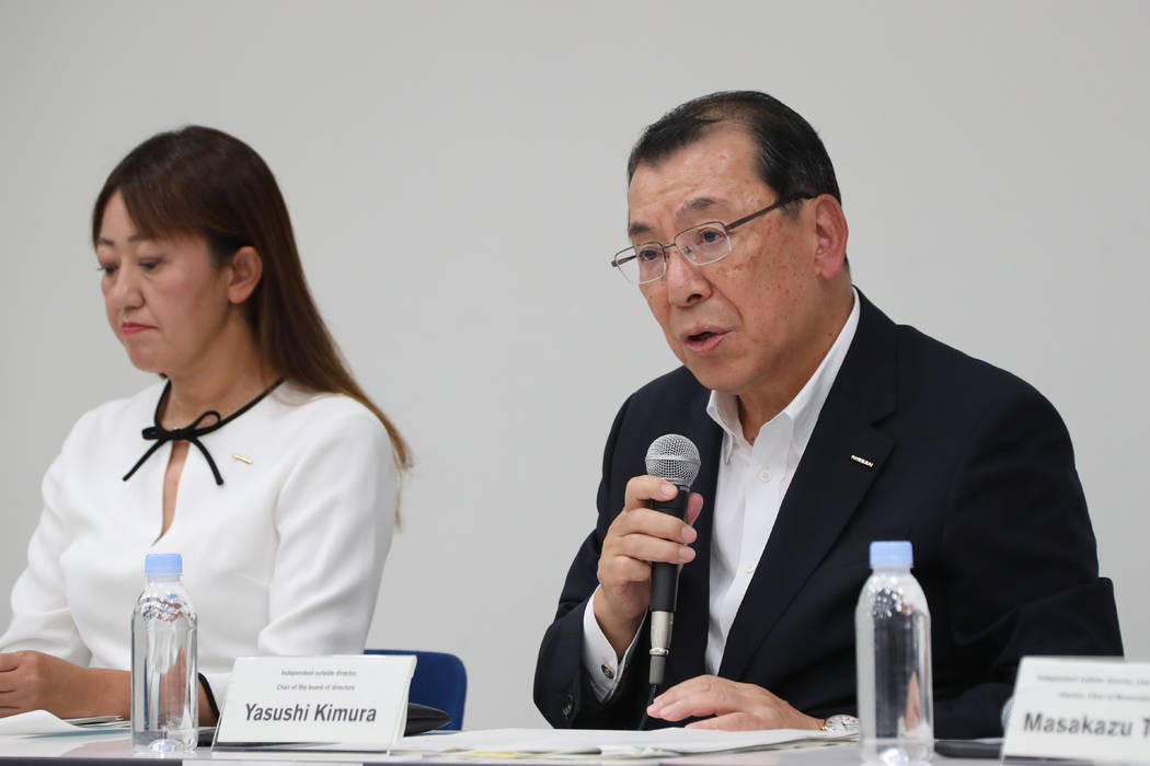 Nissan Motor Co.'s chair of the board of directors Yasushi Kimura, right, speaks during a press ...