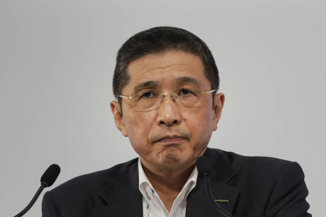 FILE - In this July 25, 2019, file photo, Nissan CEO Hiroto Saikawa listens to questions from t ...