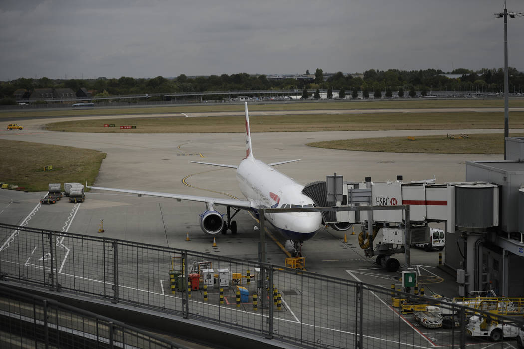 A British Airways plane sits parked at Heathrow Airport in London, Monday, Sept. 9, 2019. Briti ...