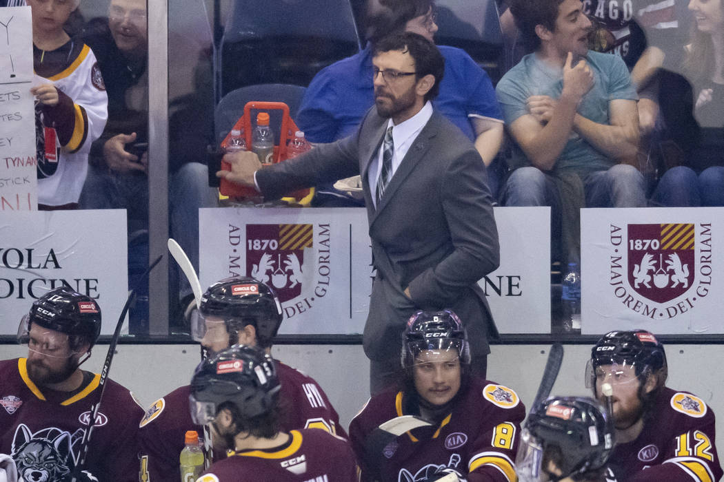 ROSEMONT, IL - JUNE 06: Chicago Wolves head coach Rocky Thompson looks on during game four of t ...