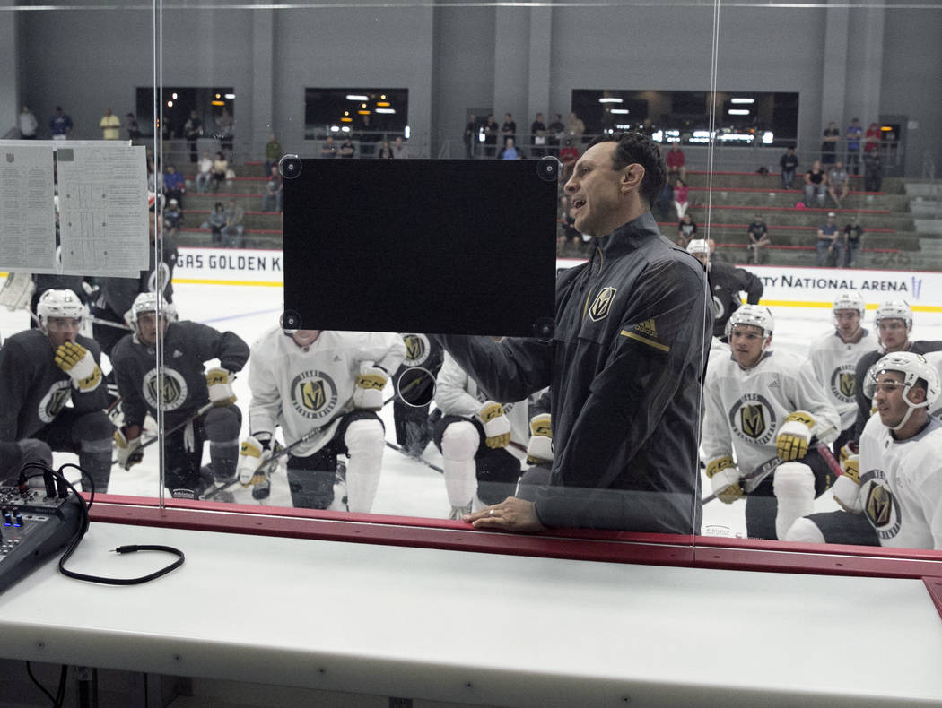 The Chicago Wolfs' coach Rocky Thompson lays out a practice plan for the Vegas Golden Knights d ...