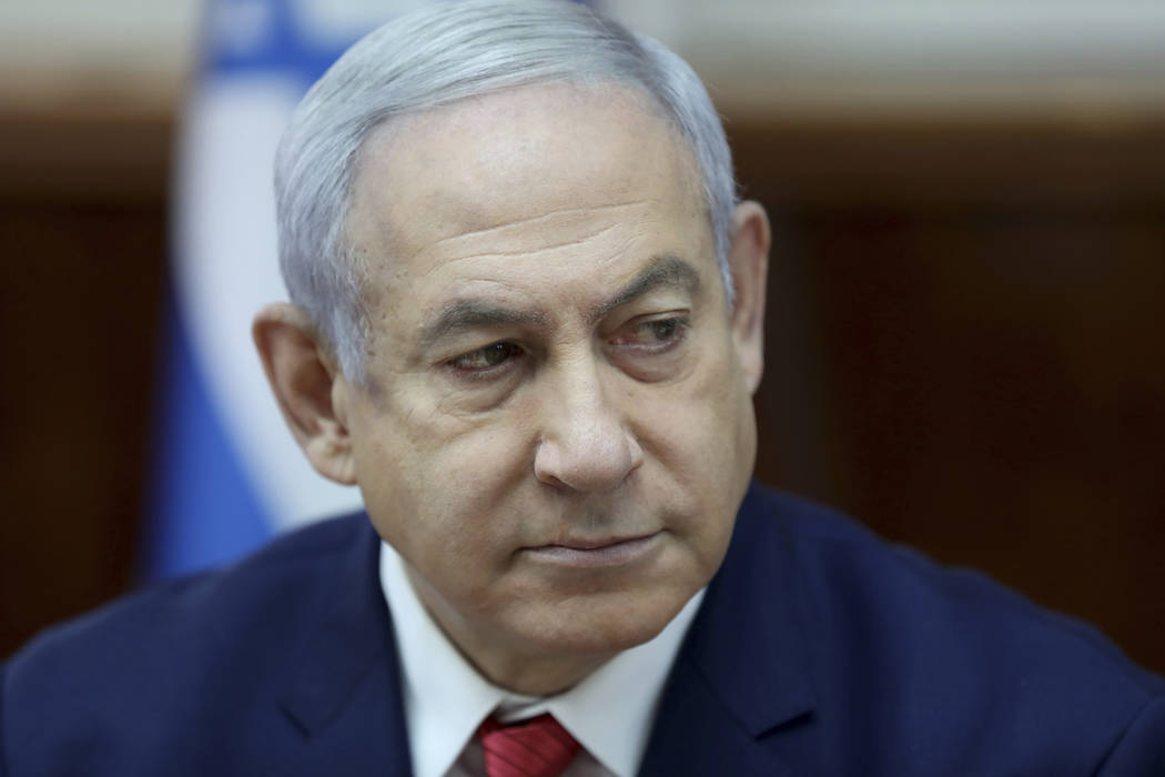 Israeli Prime Minister Benjamin Netanyahu chairs the weekly cabinet meeting, at his office in J ...