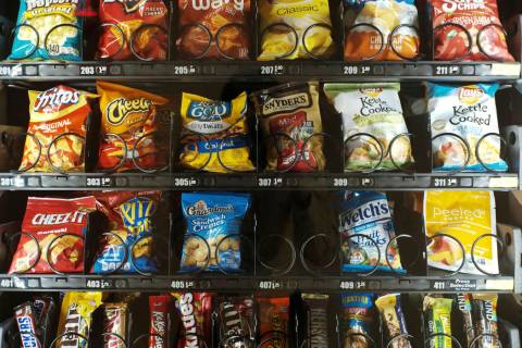 A Sept. 7, 2019, photo shows items in a vending machine in New York. Americans are addicted to ...