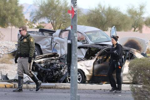 Las Vegas police investigate a three-vehicle crash at the intersection of Flamingo and El Capit ...