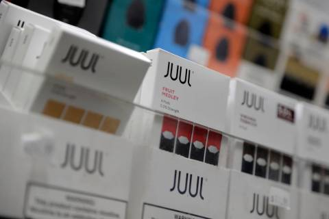 A Dec. 20, 2018, file photo shows Juul products displayed at a smoke shop in New York. Federal ...