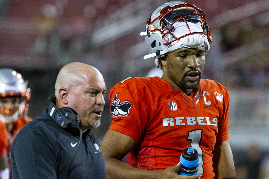 UNLV Rebels head coach Tony Sanchez talks with quarterback Armani Rogers (1) after the first qu ...
