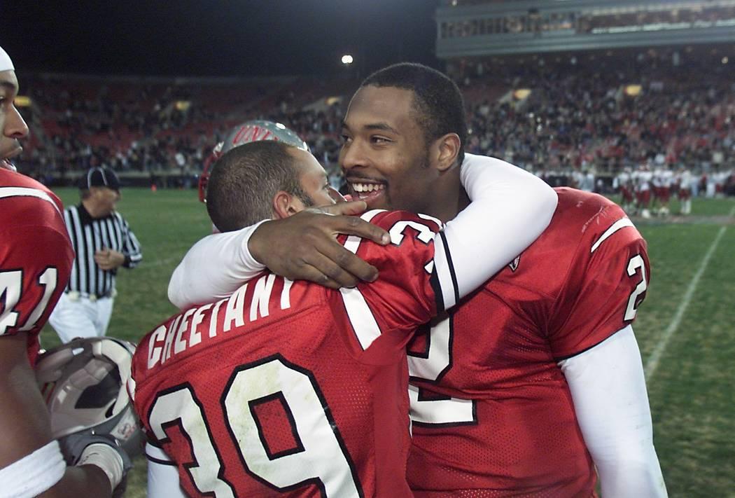 UNLV kicker/punter Ray Cheetany, left, gets a hug from quarterback Jason Thomas in the final mi ...
