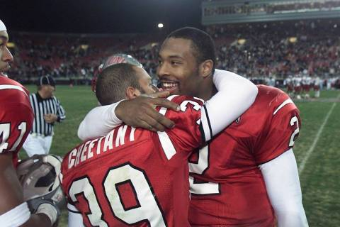 UNLV kicker/punter Ray Cheetany, left, gets a hug from quarterback Jason Thomas in the final mi ...