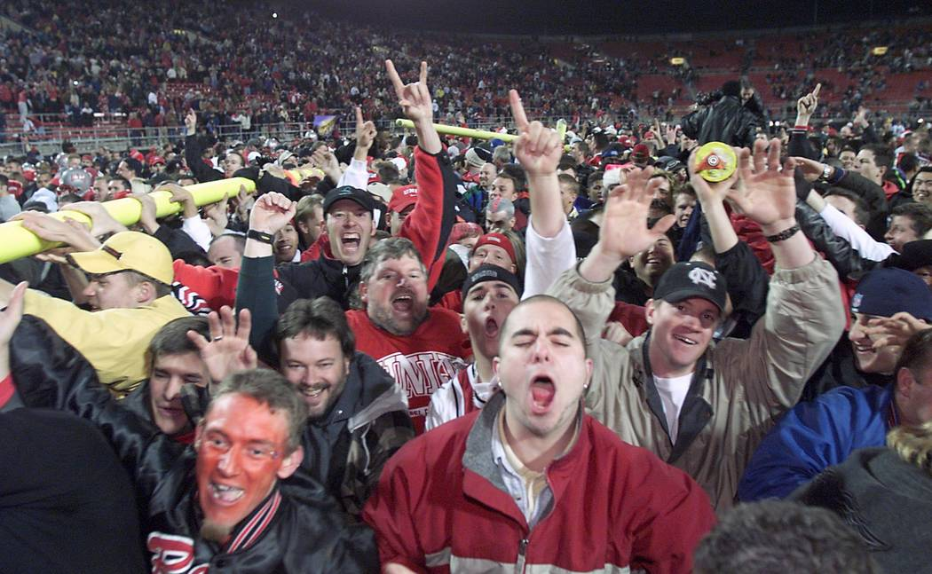 UNLV fans carry a goal post across the field after the Rebel's Las Vegas Bowl victory over Arka ...