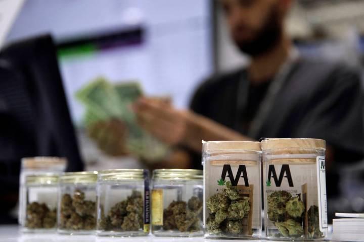 A cashier rings up a marijuana sale at the Essence cannabis dispensary in Las Vegas. (John Loch ...