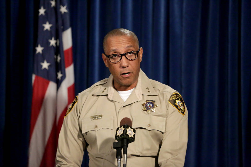 Assistant Sheriff Charles Hank briefs the media on the latest officer involved shooting at Las ...