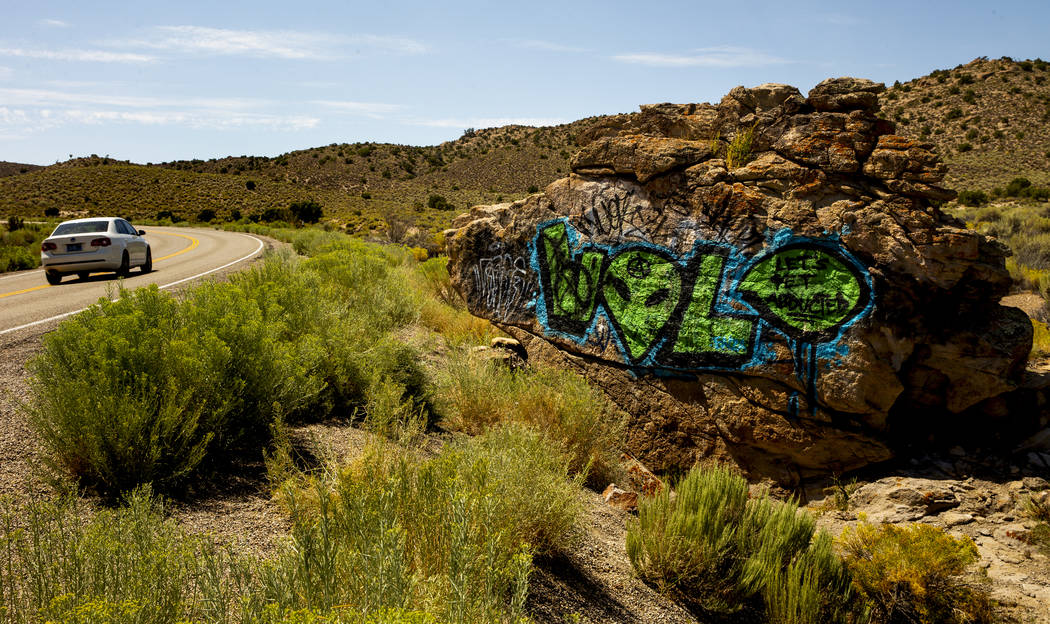 A rock is painted with an alien along the Extraterrestrial Highway/state Route 375 sits between ...