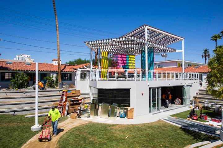 The space for Mothership Coffee is seen under construction below with a patio deck above featur ...
