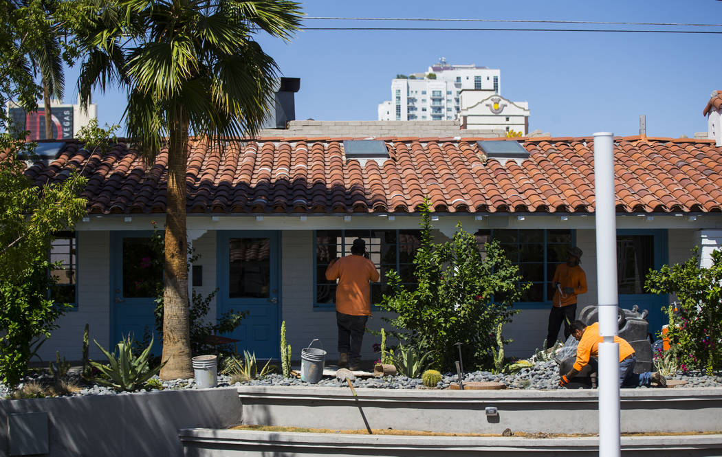 Workers update the landscaping at Fergusons Downtown at Fremont and 11th streets in Las Vegas o ...