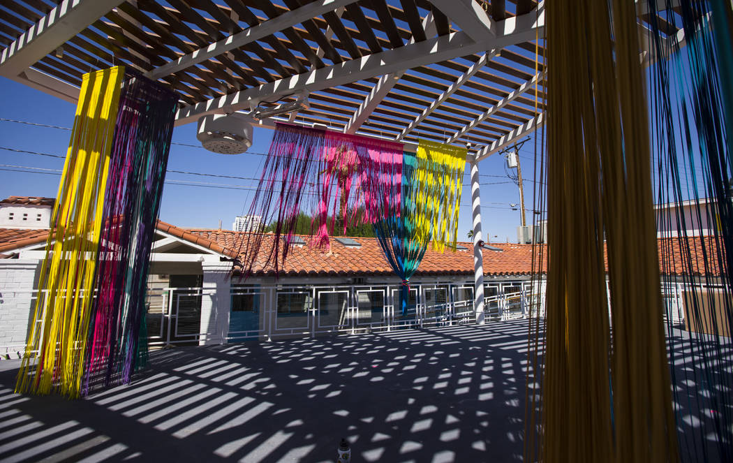 A view of the patio deck featuring an art installation by Clarice Tara at Fergusons Downtown at ...