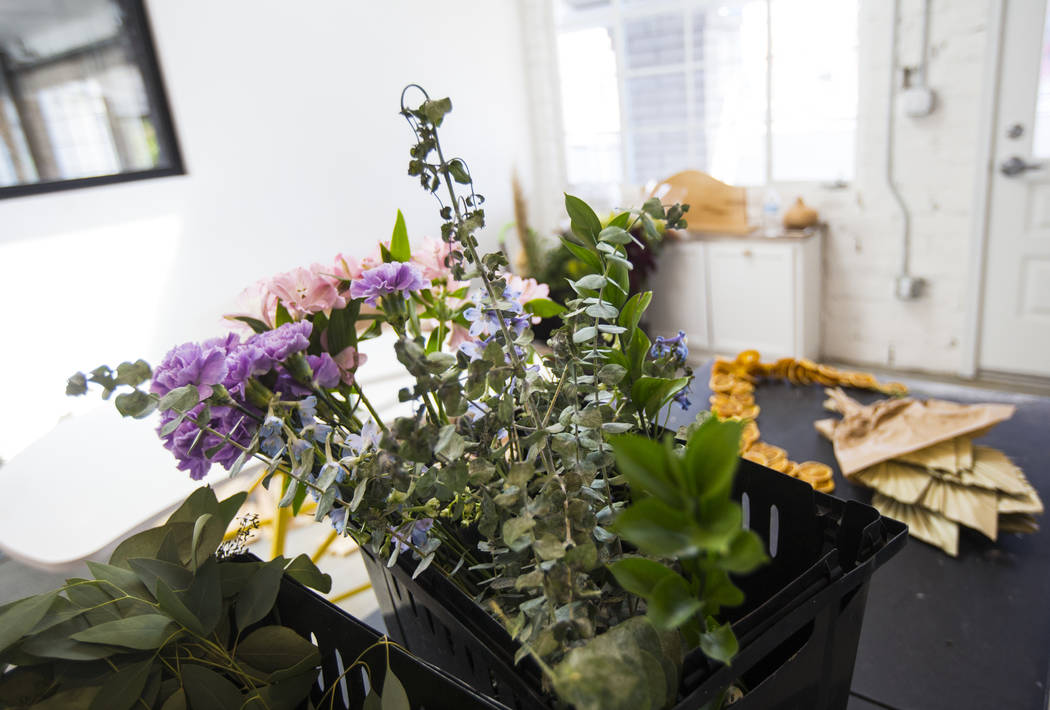 Flowers at The Tiny Bloom, a local floral shop, as setup continues at Fergusons Downtown at Fre ...