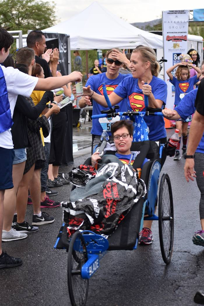 Race participants cross the finish line at a past Superhero 5K. This year's Candlelighters fund ...