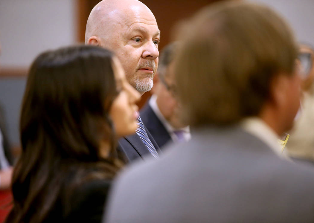 Attorney Anthony Sgro, center, speaks on behalf of his client, retired Las Vegas Convention and ...