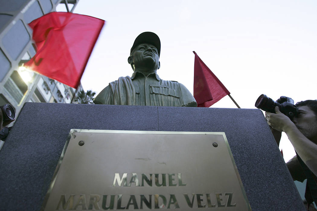 FILE - In this Sept. 26, 2008 file photo, photographers take pictures of a bust of the late Man ...
