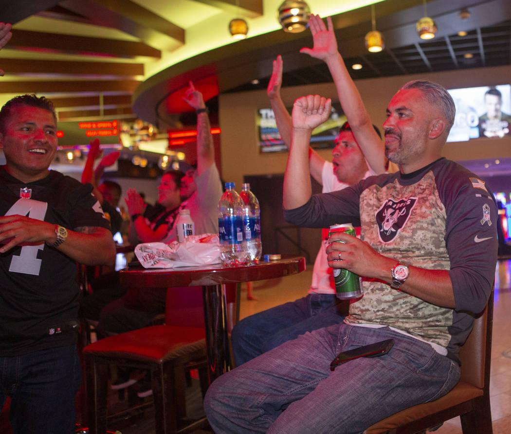 Freddy Garcia, right, celebrates after a Oakland Raiders touchdown with Rafael Garcia, backgrou ...