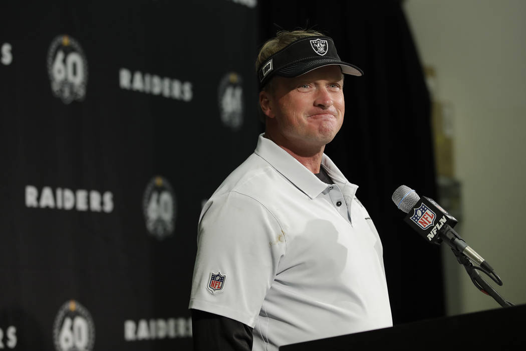 Oakland Raiders head coach Jon Gruden smiles during a news conference at the end of an NFL foot ...