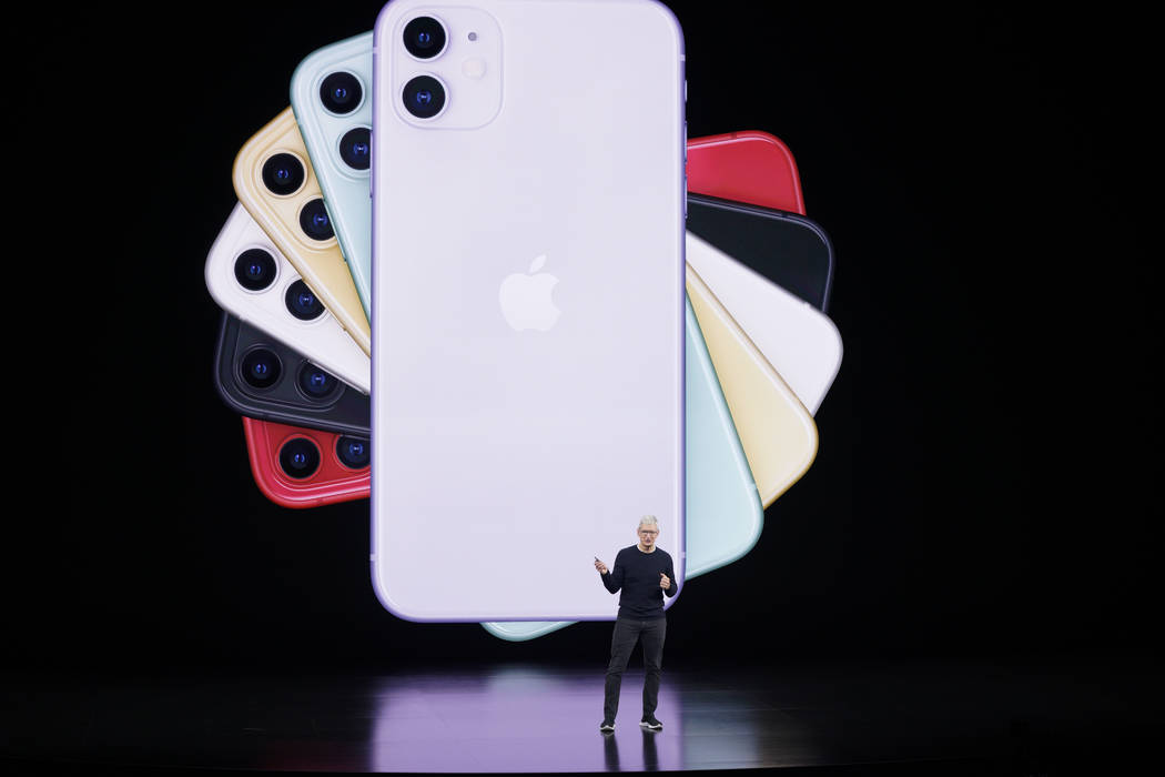 Apple CEO Tim Cook talks about the latest iPhone during an event to announce new products Tuesd ...