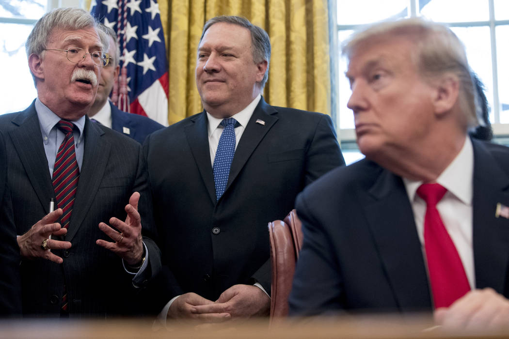 National Security Adviser John Bolton, left, with by Secretary of State Mike Pompeo, stand behi ...