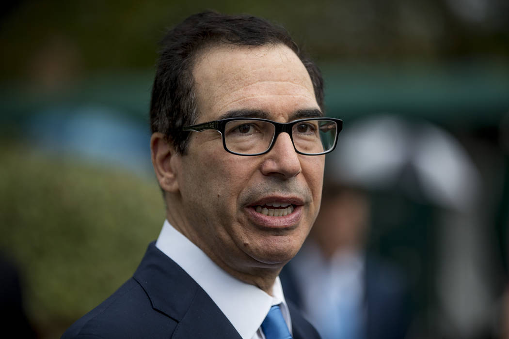 In a Sept. 9, 2019, photo, Treasury Secretary Steve Mnuchin speaks to reporters outside the Wes ...