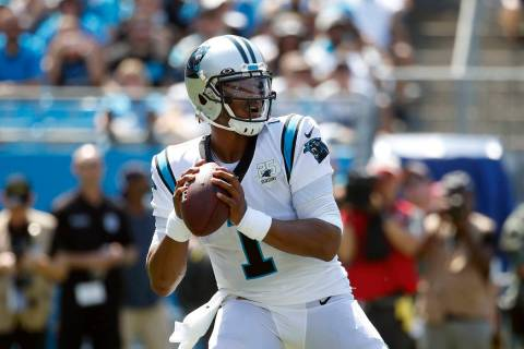 Carolina Panthers quarterback Cam Newton (1) looks to pass against the Los Angeles Rams during ...
